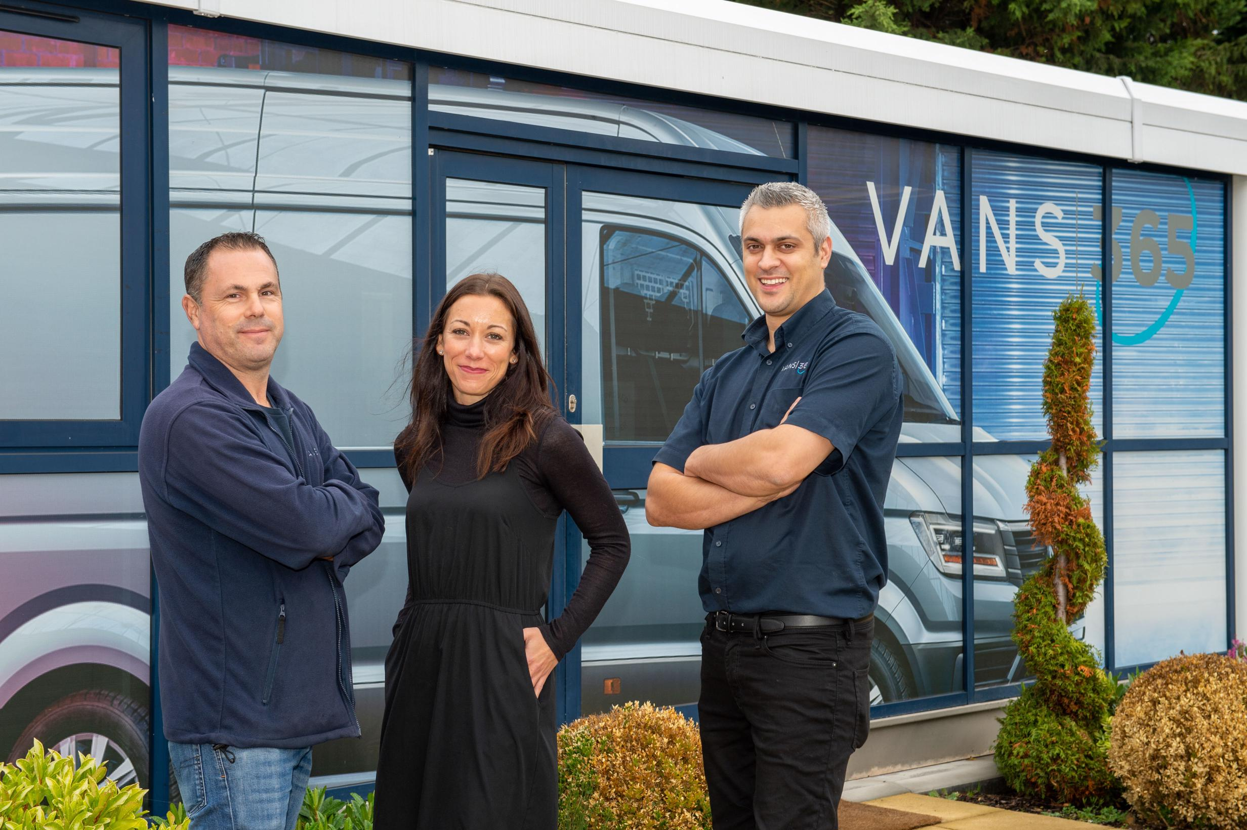 Members of the Vans 365 team standing in front of the Vans 365 office
