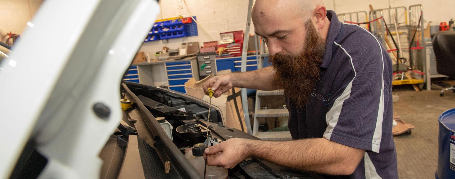 Service Technician Working At Vans 365
